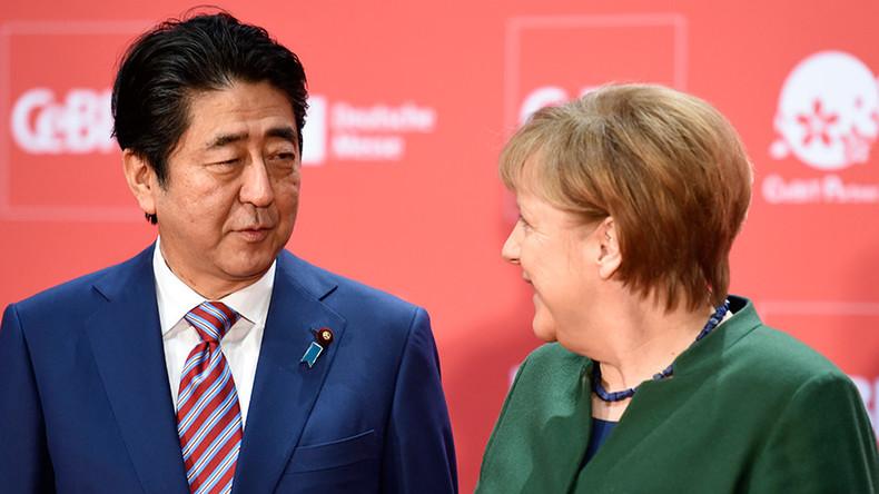 Merkel, Abe defend globalization, calling for EU-Japan trade agreement