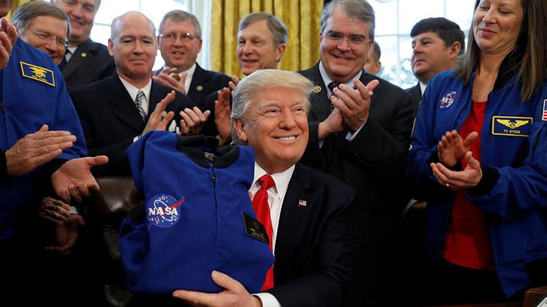 Trump signs NASA funding bill to send astronauts to Mars