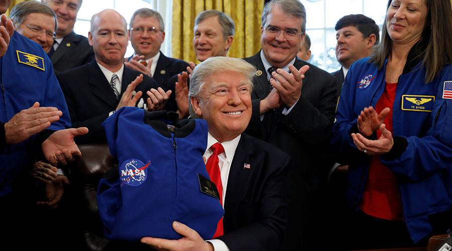 Trump signs NASA funding bill to send astronauts to Mars