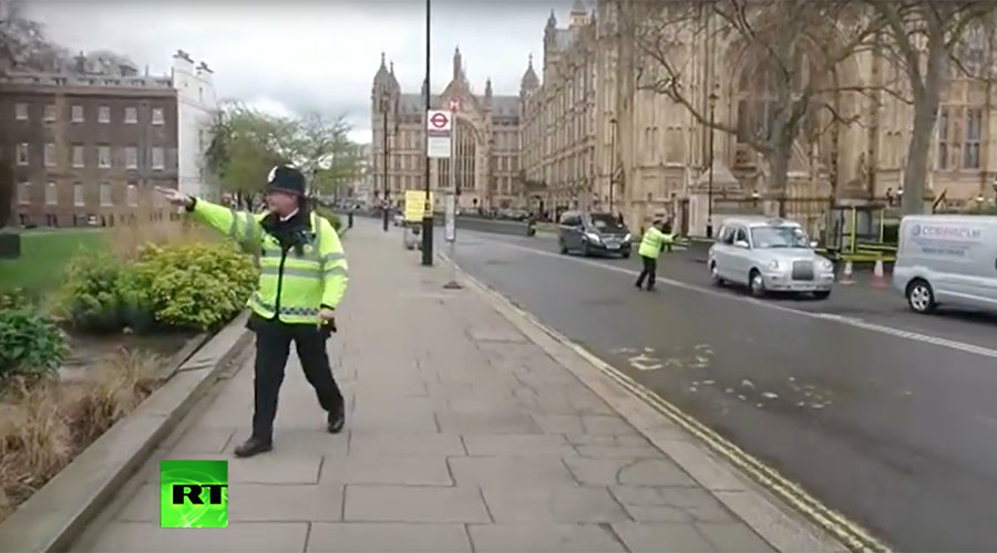 'Stay under cover!': Police evacuation captured in dramatic footage after Westminster attack (VIDEO)