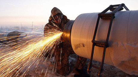 A Gazprom worker welds a part of a pipeline © Denis Sinyakov