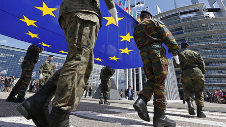 FILE PHOTO: Soldiers of the Eurocorps hold the European flag © Jean-Marc Loos