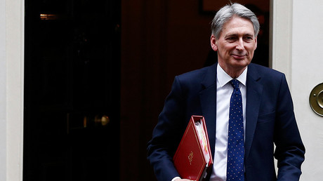 Hammond expected to build up Brexit cushion in budget statement