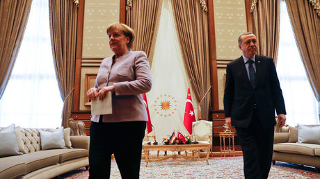 Turkish President Recep Tayyip Erdogan and German Chancellor Angela Merkel © Umit Bektas
