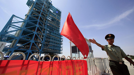 FILE PHOTO: A soldier gestures in front of the launch pad, Gansu province. © Jason Lee