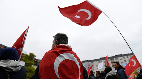 FILE PHOTO: Turkish flags during a protest meeting outside the Bredangsskolan school in southern Stockholm, Sweden. © Henrik Montgomery / TT News Agency / via Reuters