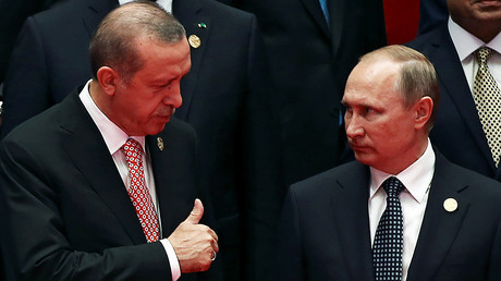 File photo: Russia's President Vladimir Putin interacts with Turkey's President Tayyip Erdogan © Damir Sagolj