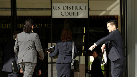 Hawaii Attorney General Douglas Chin (R) arrives at the U.S. District Court Ninth Circuit in Honolulu, Hawaii, March 15, 2017 © Hugh Gentry