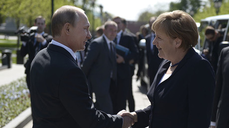 FILE PHOTO: Russian President Vladimir Putin and German Chancellor Angela Merkel  in Moscow, Russia, May 10, 2015 ©Reuters