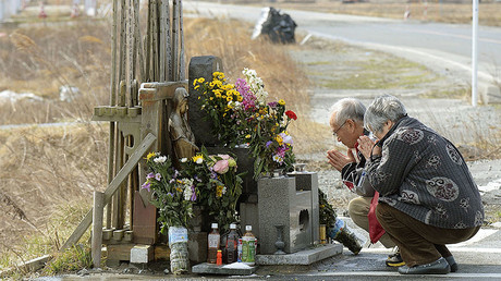 People pray for victims of the March 11, 2011 earthquake and tsunami near Tokyo Electric Power Co's (TEPCO) tsunami-crippled Fukushima Daiichi nuclear power plant © Kyodo