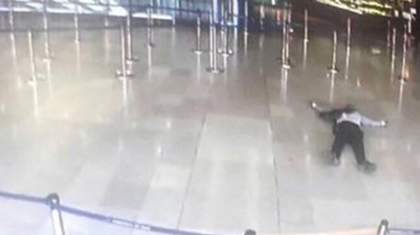 A picture taken of a television screen on March 18, 2017 shows a man lying on the ground of a terminal building at Paris' Orly airport © AFP