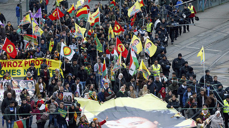 People hold placards during a demonstration organised by Kurds, in Frankfurt, Germany, March 18, 2017. © Ralph Orlowski