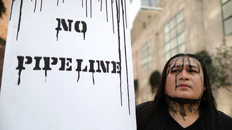 People protest against President Donald Trump's executive order fast-tracking the Keystone XL and Dakota Access oil pipelines. © Lucy Nicholson