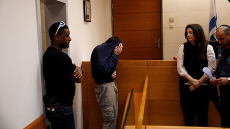 U.S.-Israeli teen (2ndL) arrested in Israel on suspicion of making bomb threats against Jewish community centers in the United States, Australia and New Zealand over the past three months © Baz Ratner