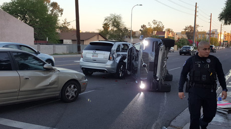 A self-driven Volvo SUV owned and operated by Uber Technologies Inc. is flipped on its side after a collision in Tempe, Arizona, U.S. on March 24, 2017. © Fresco News / Mark Beach / Handout via Reuters
