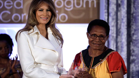 First lady Melania Trump presents Veronica Simon of Papua New Guinea with the 2017 Secretary of State's IWOC Award during a ceremony at the State Department in Washington, U.S., March 29, 2017. ©Reuters