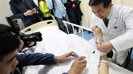 Doctors could hear blood circulating in the ear after the surgery. © China Daily / via Reuters