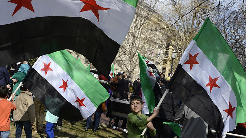 Speakers at rebuilding Syria conference abused for 'sharing platform with Assad ministers'