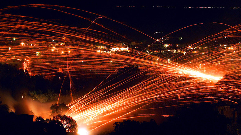 'Rocket War' returns to sleepy Greek island as thousands of fireworks light up night sky (VIDEO)