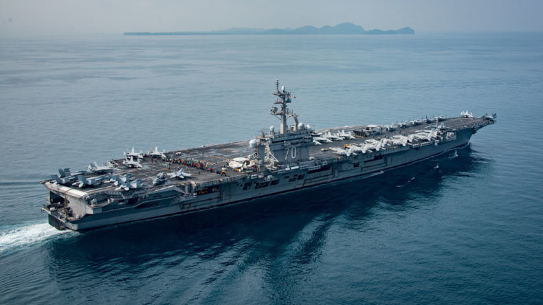 China's Xi urges restraint during Trump call as 'USS Carl Vinson' heads for Korean waters