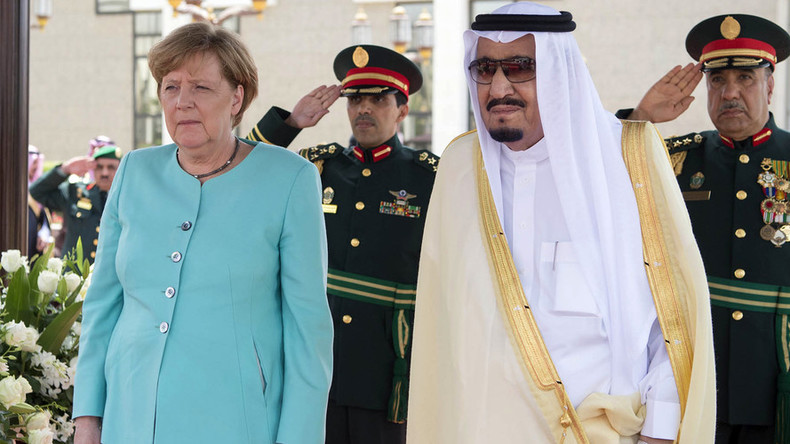 Merkel meets Saudi King without hijab, talks business, not women's rights