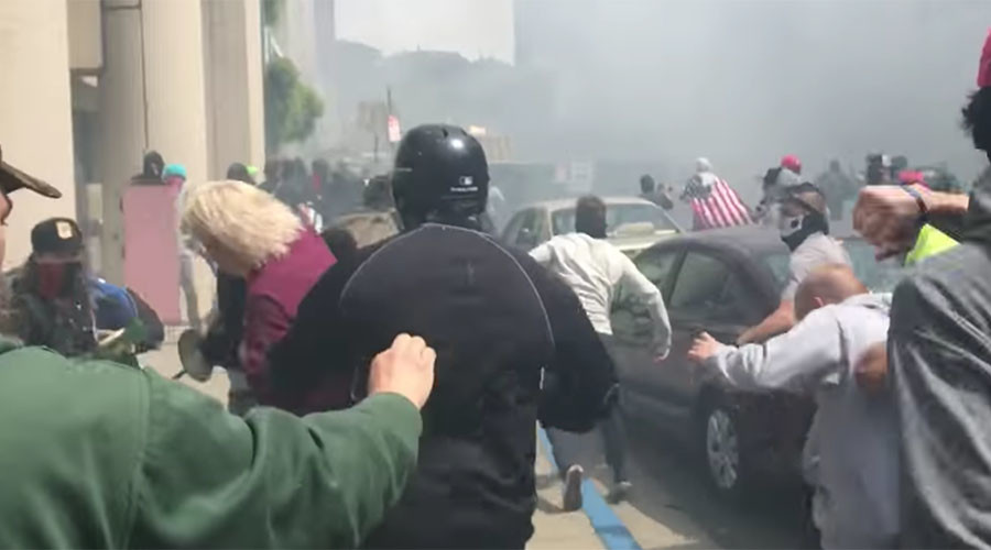 Calls for White Supremacist's arrest after sucker punching woman at 'Battle of Berkeley' (VIDEO)