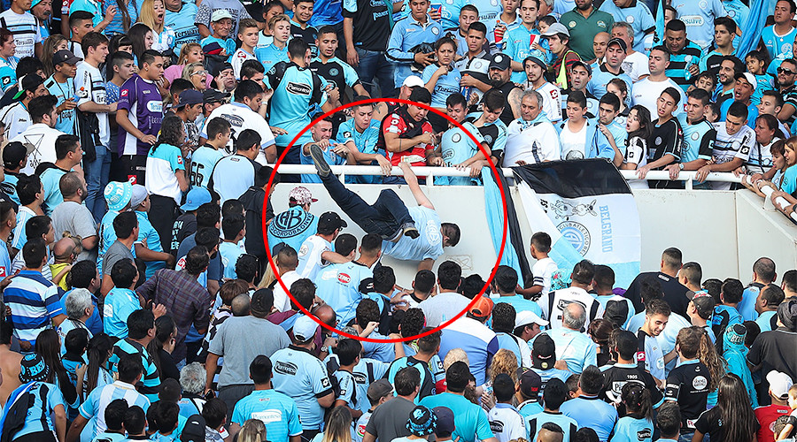 Argentine football fan dies after being mistaken for rival supporter & chased from stands (VIDEO)