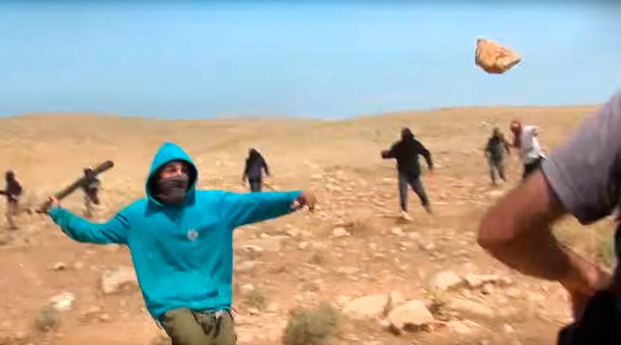 Masked Israeli settlers assault Jewish-Arab activists with stones, sticks (VIDEO)
