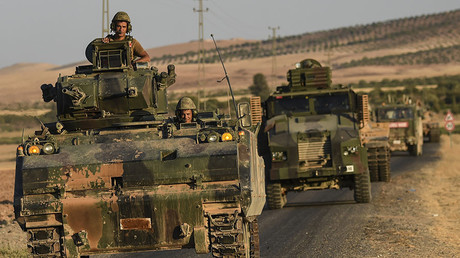 Turkish soldiers driving back to Turkey from the Syrian-Turkish border town of Jarabulus. September, 2016. © AFP