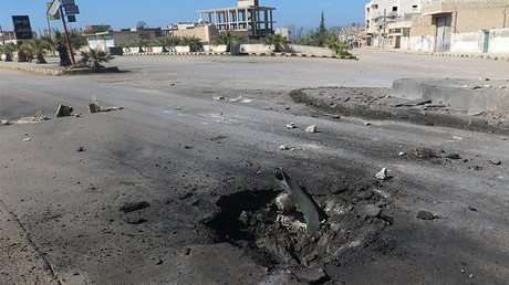 A crater is seen at the site of an airstrike, after what rescue workers described as a suspected gas attack in the town of Khan Sheikhoun in rebel-held Idlib, Syria April 4, 2017. © Ammar Abdullah
