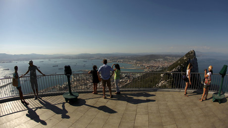 Tourists stand on a terrace of the Rock, a monolithic limestone promontory, in the British overseas territory of Gibraltar, south of Spain © Jon Nazca