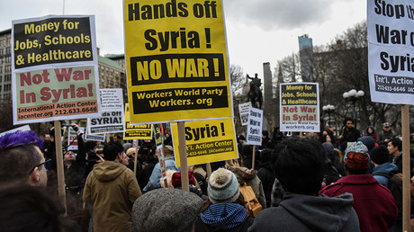 People participate in a demonstration against the recent U.S. strike in Syria, in New York, U.S., April 7, 2017. © Stephanie Keith