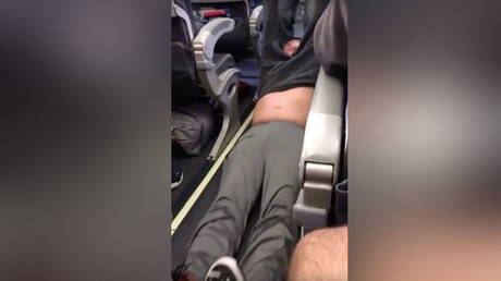 Police forcibly remove passenger at behest of United Airlines in disturbing footage