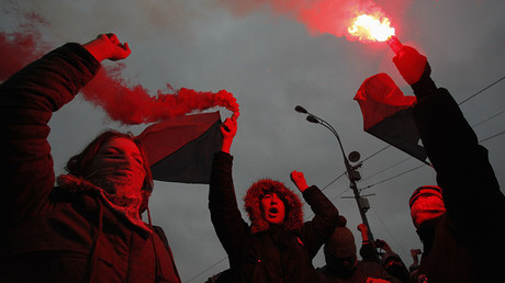 Members of a local anarchist movement burn flares during a sanctioned rally in Bolotnaya square in Moscow December 10, 2011. © Anton Golubev