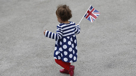 A toddler with a Union flag at a