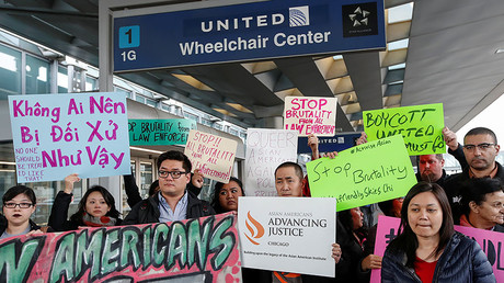 Community members protest the treatment of Dr. David Dao at O'Hare International Airport in Chicago, Illinois, U.S., April 11, 2017. © Kamil Krzaczynski