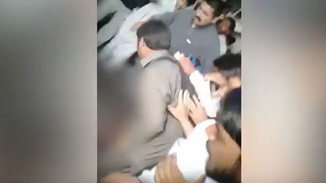 Screenshot from the alleged video of the beating © Dawn.com's video channel