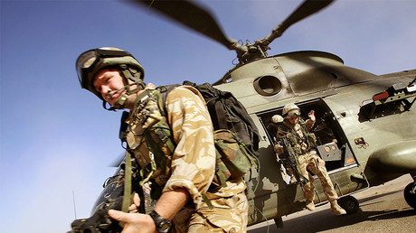 FILE PHOTO: British soldiers jump out of a helicopter © Damir Sagolj