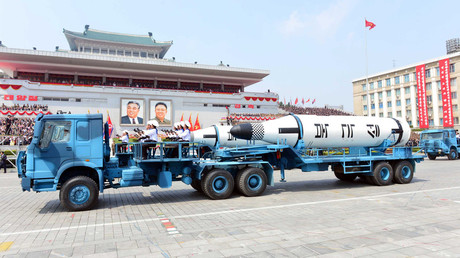 FILE PHOTO: Military vehicles carry missiles during a military parade. © KCNA