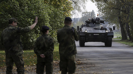 FILE PHOTO: German army soldiers arrive for the NATO military drill in Adazi, Latvia. © Ints Kalnins