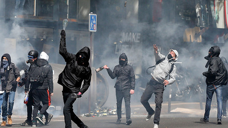 Hooded youths throw bottles during clashes at a demonstration to protest the results of the first round of the presidential election in Paris, France, April 27, 2017. © Gonzalo Fuentes