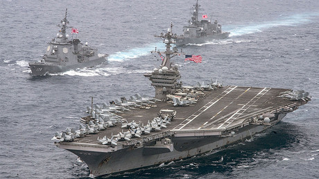 The U.S. Navy aircraft carrier USS Carl Vinson leads the Japan Maritime Self-Defense Force (JMSDF) Atago-class guided-missile destroyer JS Ashigara (L) during a transit of the Philippine Sea April 26, 2017. © U.S. Navy