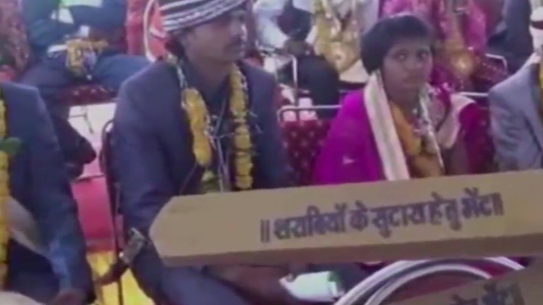 Indian minister arms 700 new brides with wooden bats against drunk & abusive husbands