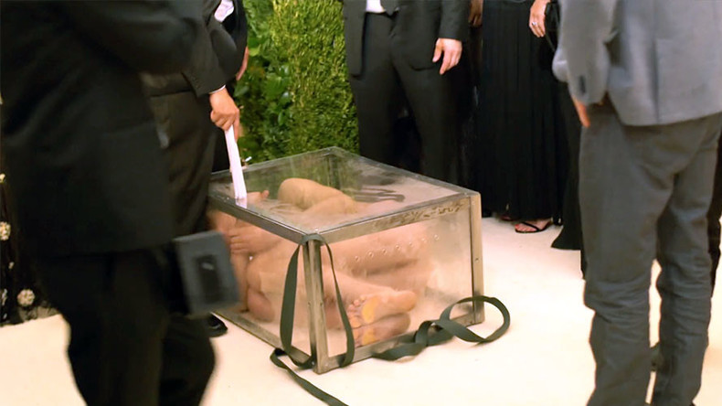 Rude nude? Naked Russian artist arrested after crashing Met Gala squashed in glass box (VIDEO)