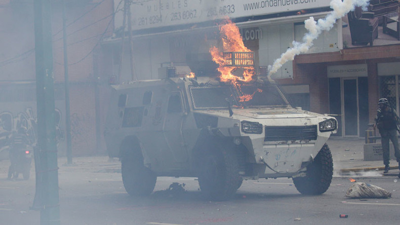 Armored vehicle set on fire plows through crowd in Venezuela (VIDEO)