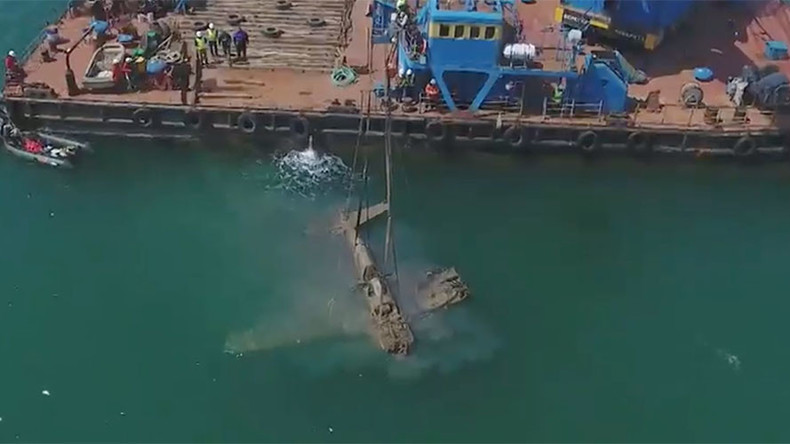 Drone captures lifting of US-made warplane that sank near Russia in WW2 (VIDEOS)