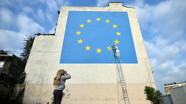 New Brexit-themed Banksy shows workman chipping away at EU flag