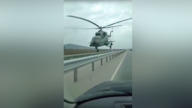 Chopper buzzes Chechen highway, narrowly avoids collision with vehicle (VIDEO)