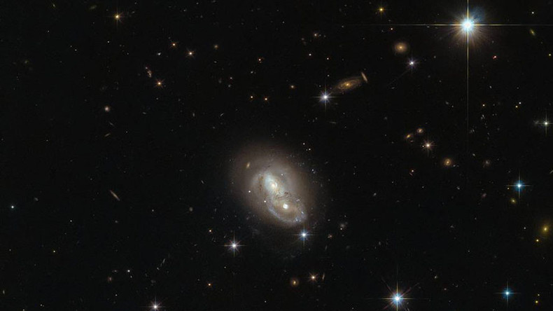 Hubble snaps 2 galaxies hurtling past each other at over a million mph (PHOTO)