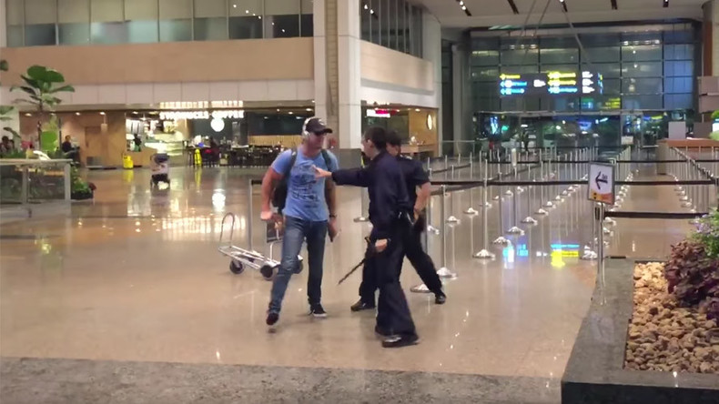 Drunken Aussie faces caning after expletive-laden scuffle with Singapore police at airport (VIDEO)